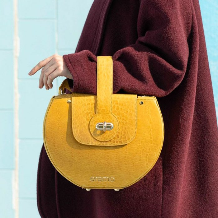 Handbag by Eremo Bag: bag with oval shape and handle positioned vertically in yellow coconut printed cowhide.