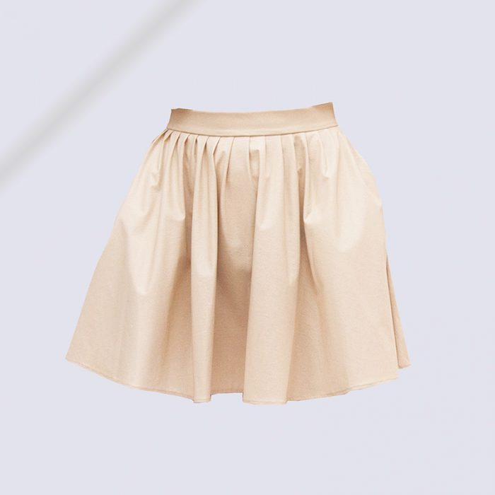 Fili Pari skirt in powder of Giallo Moro Marble, short, pleated, flared and cream-colored