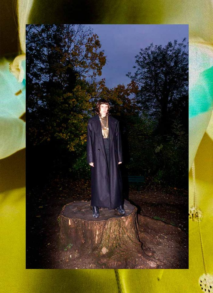 FSTD clothing: the model wears an oversized dark coat that runs down to her ankles