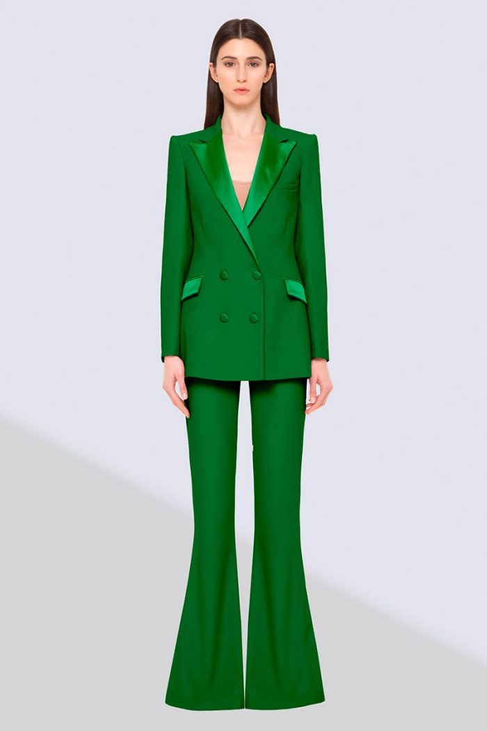 look by HEBE STUDIO:the model wears a forest green tailored suit; double-breasted blazer, viscose satin cuff and pockets; high waisted wide-leg trousers