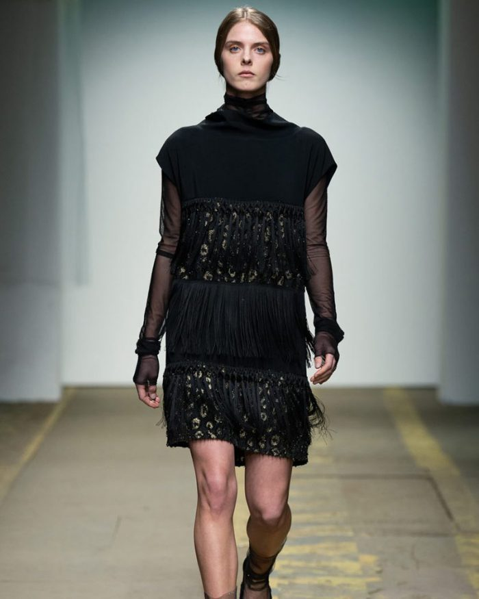 Italo Marseglia black mini dress with high collar, long sleeves with transparency effect, spotted print detail and fringes