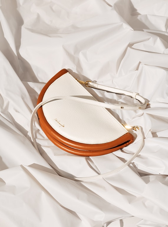 white and cognac colored melip shoulder bag in leather
