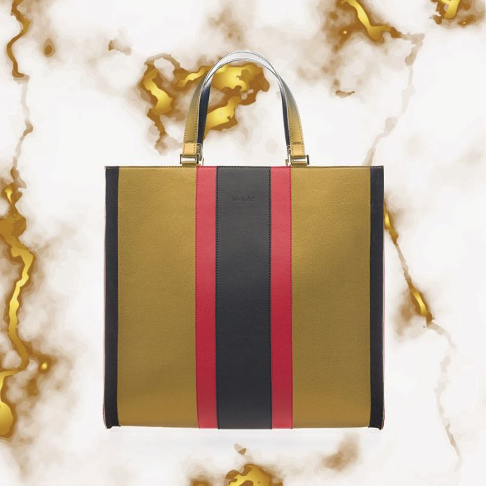 Large gold-colored Adelaide Carta eco bag with black stripe and red stripes