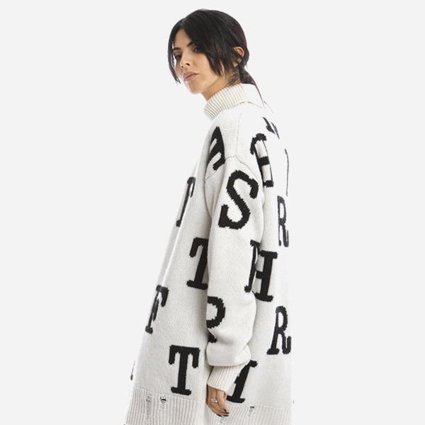 White Spendthrift sweater with black lettering