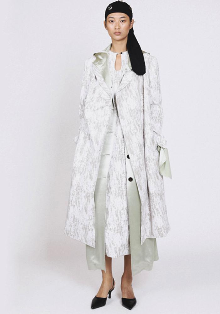 White trench coat with gray print by Jing Yu
