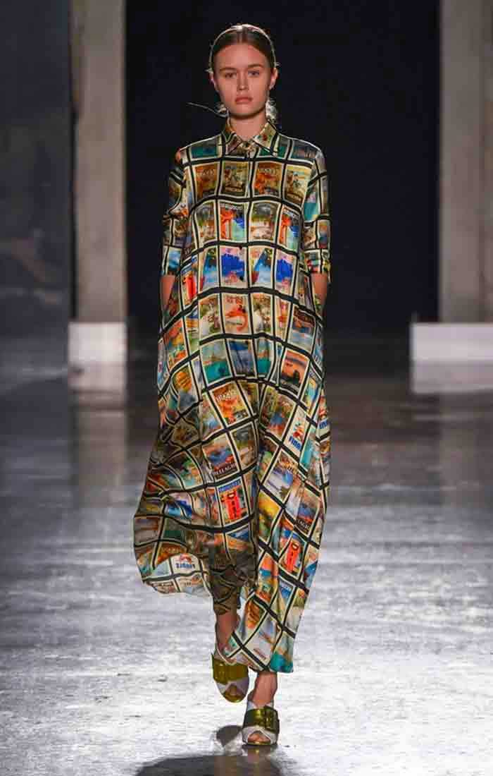 SS 2020 Ultràchic fashion show: model wearing long chemisier dress printed with vintage postcard designs