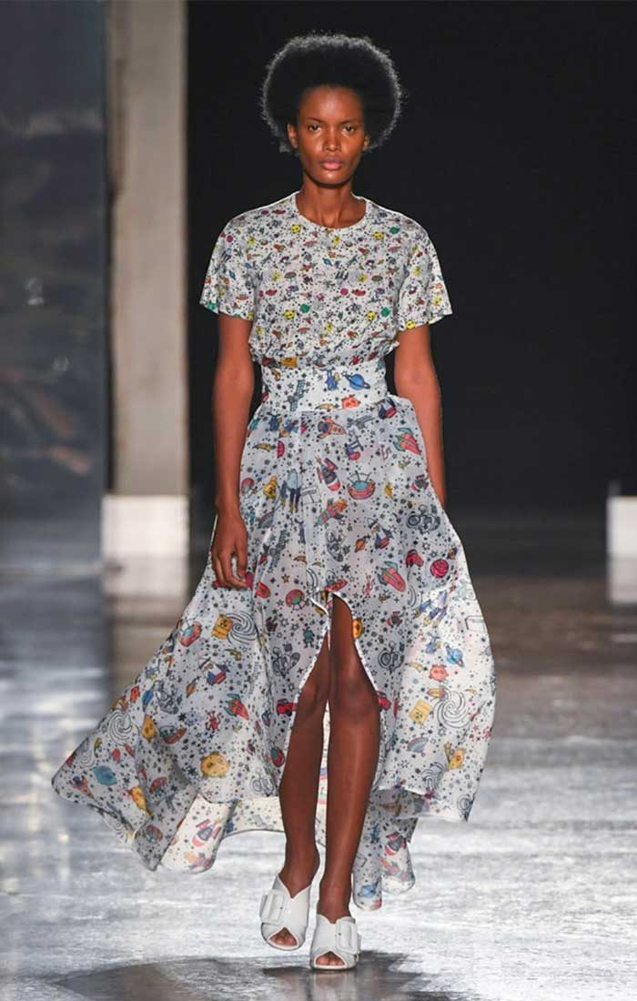 SS 2020Ultràchic fashion show: model wearing a long t-shirt and matching skirt with a central space print