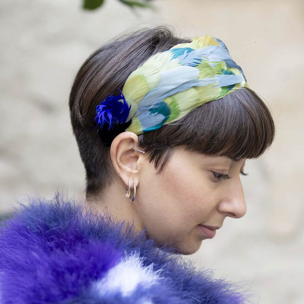 Aida Hairband - Nan√Ý Firenze.¬ÝFeathers are meticulously¬Ýplaced on the structured band¬Ýto create a trailing, fan-like¬Ýshape that'Äôs simply unique.¬ÝThe handband may be¬Ýavailable in different versions.