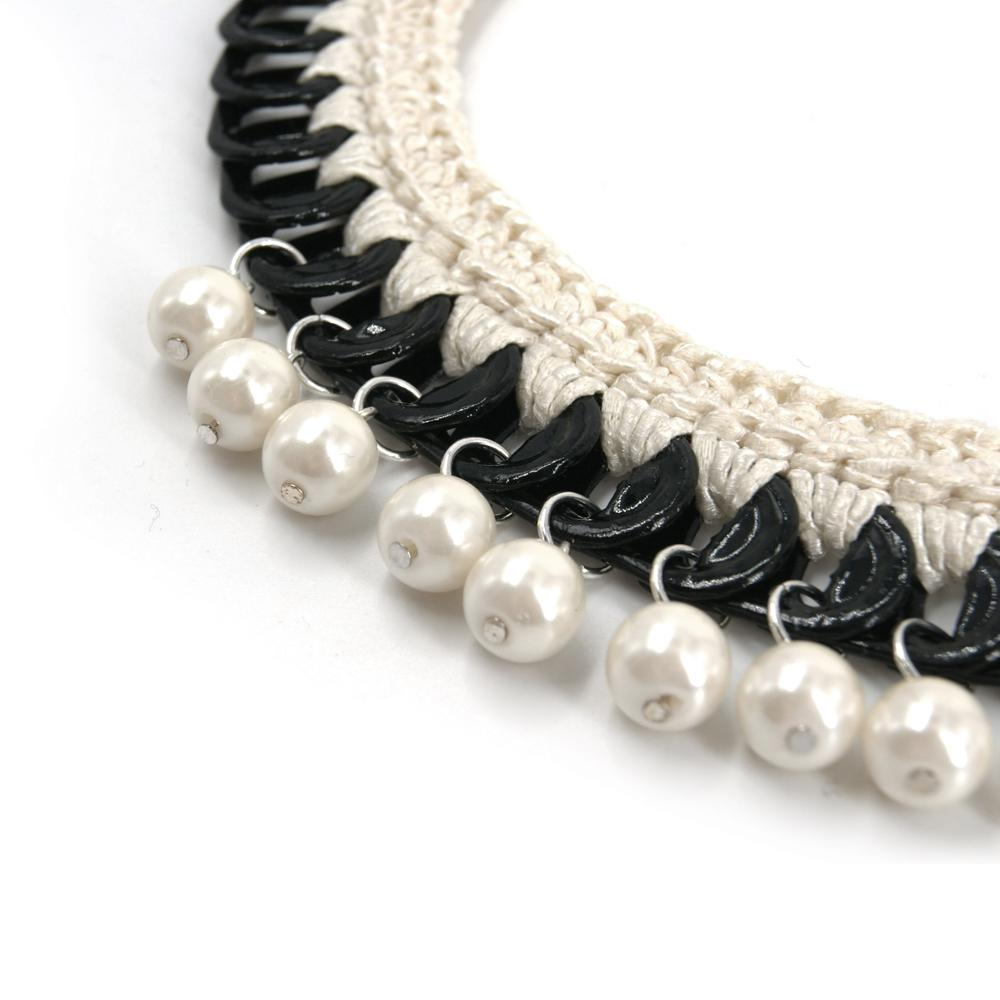 Manifesto Necklace - Peekaboo!.¬ÝBlack glossy pop tops necklace with cotton cream color crochet and resin pearls.