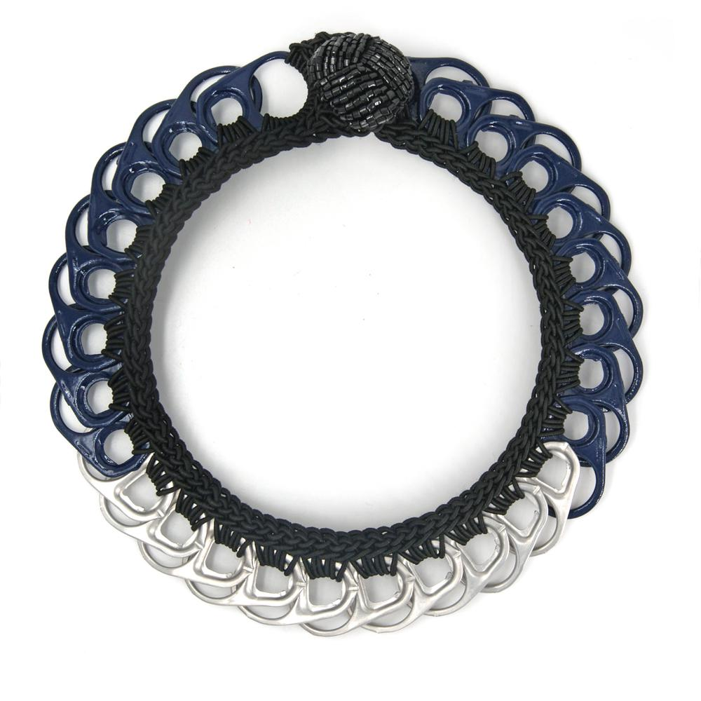 Essenziale Necklace - Peekaboo!.¬ÝBold pop tops and shiny crochet. You can have 2 necklaces in one piece: wear it with the button on the back for a silver collar, or with the button on front for a dark blue choker.¬Ý