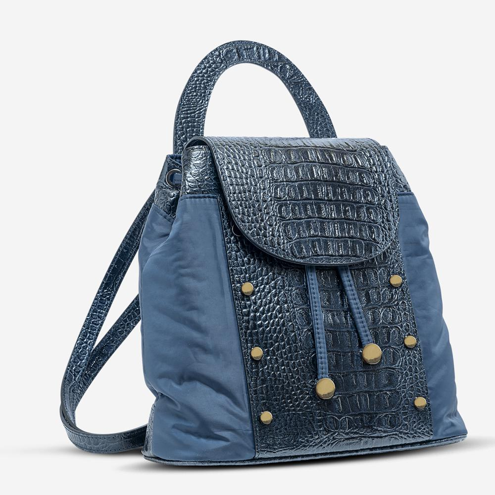 Ilaria Blue Backpack - Kilesa. Back pack in calf leather and textile. Adjustable leather handle and shoulder straps. Drawstring closure. Hardwear and studs in gunmetal.