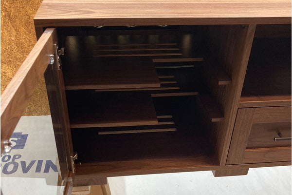 custom walnut media console with special shelves to accomodate a gaming console vertically