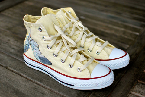 White Converse Chuck Taylor Hi Tops featuring dream catcher feathers and Indian Chief Skull wearing Native Head dress.
