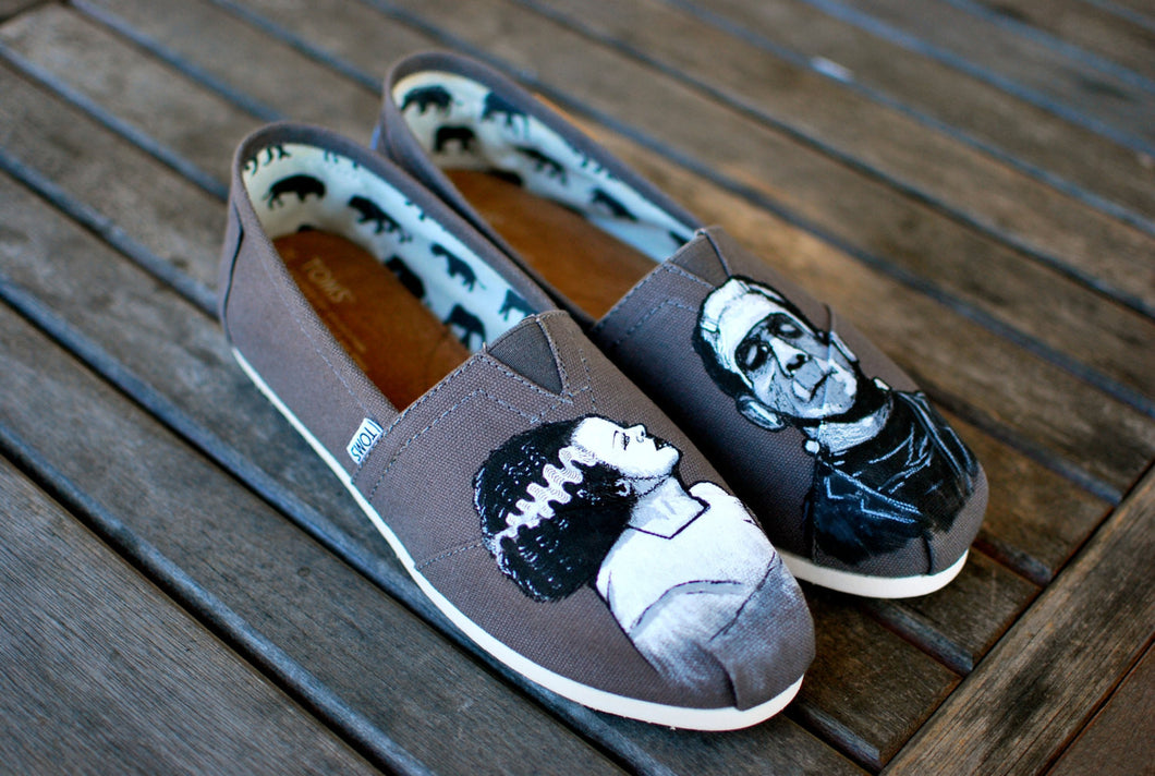 Frankenstin and Bride of Frankenstein painted on Ash Grey Classic Toms shoes