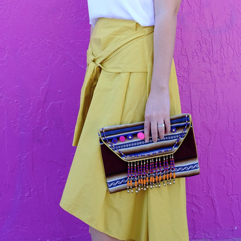 - Pom Pom Spring Striped Clutch