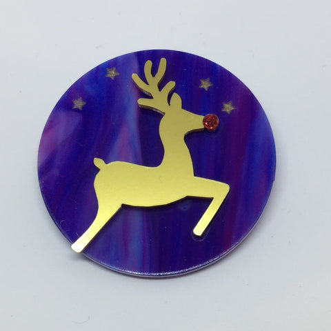 Reindeer disc brooch