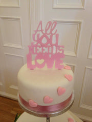 'All you need is love' wedding cake topper