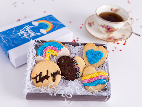Our irresistible NHS Thank you rainbow themed hand made biscuits are presented in a...
