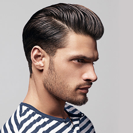 Marcus' longer tapered cut is styled using Hard Water Pomade and a Baxter of California wide-toothed comb, then perfected with a smart side part.