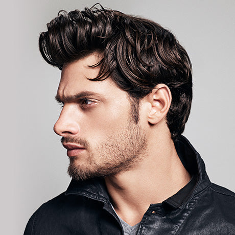 Wavy, medium-length hair is given a lived-in style on Marcus with Hard Cream Pomade, adding moisture and hold without being heavy.