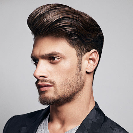 Marcus' classic pompadour is styled into shape with Grooming Lotion and held in place with Hard Water Pomade.