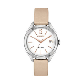 The Citizen Eco-Drive women's watch is sleek and minimal featuring a beige strap.