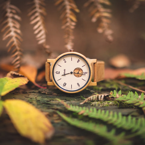 Unlike digital watches, an analog watch features a traditional clock face, dial, and hands.