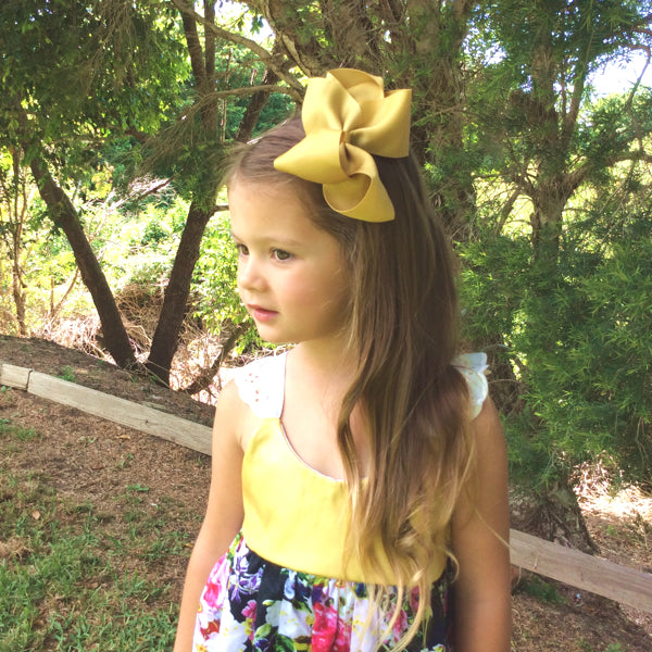 Callie in AAA Gold Bow Clip