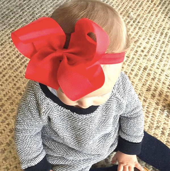 Everly wears Willow big bow baby headband