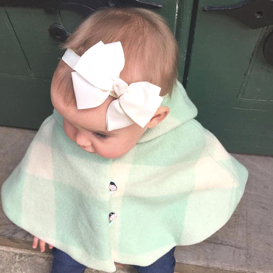 Miss Isla wearing our beautiful Lani clutch bow in classic ivory