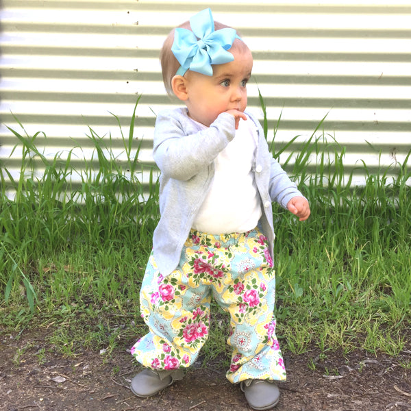 Isla Rose wearing Padma petal loop bow baby headband