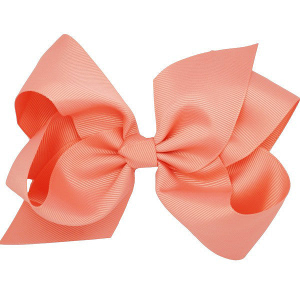 Charlotte coral medium bow hair clip