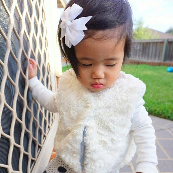 Little cutie wearing our white pinwheel bow clip