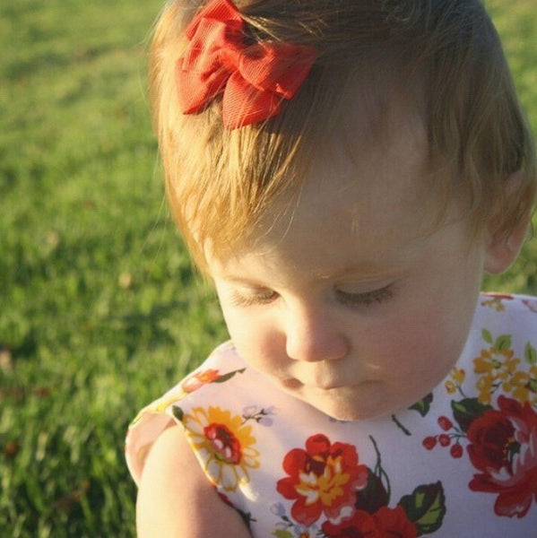 Ivy wearing Bea mini bow hair clip for babies and toddlers