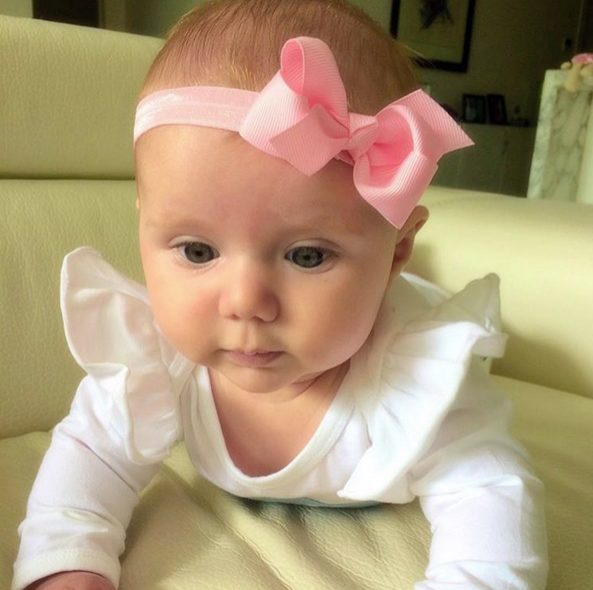 Pink stretchy newborn baby headband (by Pretty Little Clippies Australia)