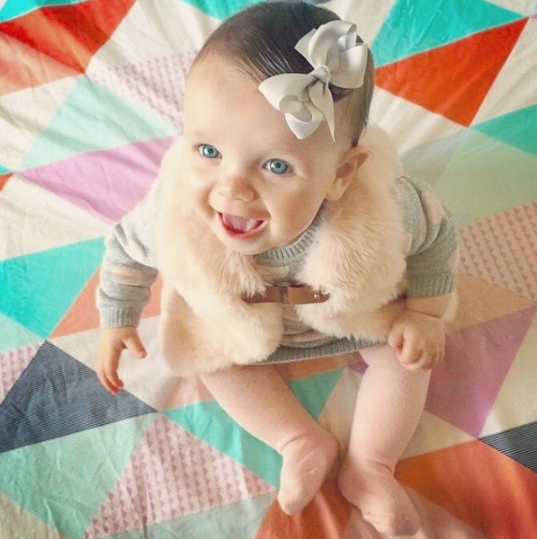 Pretty Little Clippies bow hair clip modelled by beautiful smiling baby