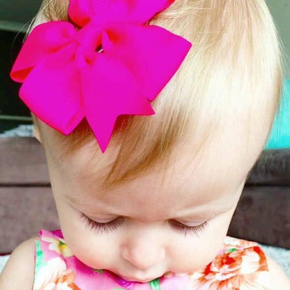 Emmy fuchsia pinwheel bow clip for baby girls