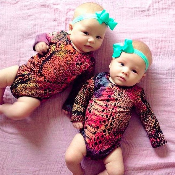 Gorgeous twin girls wearing Pretty Little Clippies Australia stretchy newborn baby headbands