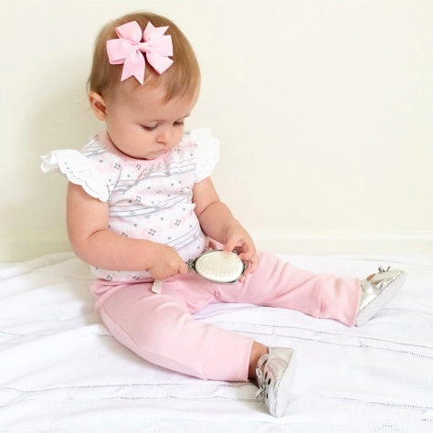 Melissa pinwheel bow in classic pink for baby girls