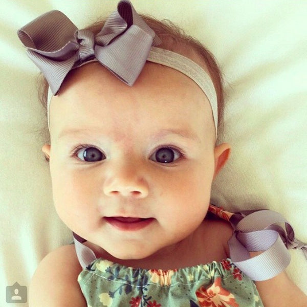 ... Everly Wearing Bree Baby Headband Pretty Little ... f9b53a61c9d