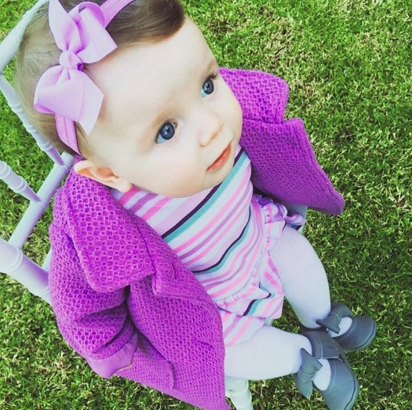 Sweet Poppy wears our beautiful Iris bow baby headband in lilac