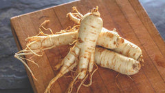 photo of ginseng root on wood-sexual aphrodisiac-www.rdalchemy.com