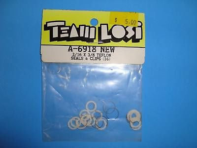 TEAM LOSI 3/16X3/8 TEFLON SEALS &CLIPS (16) #A-6918