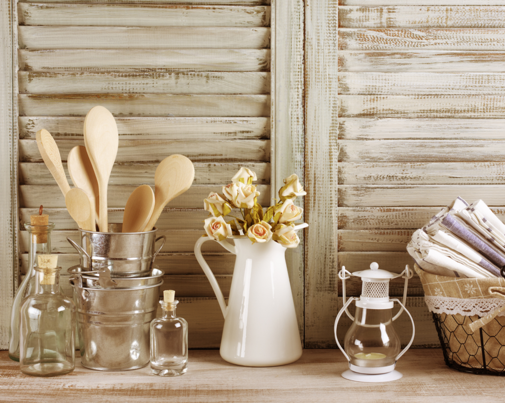 wooden spoons with flower pitcher vase and glass bottles