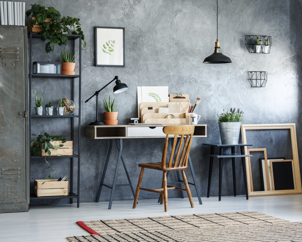 modern desk set up with wooden chair and plants
