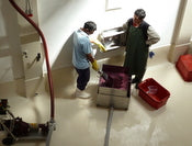 Pumping over fermenting wine to release alcohol
