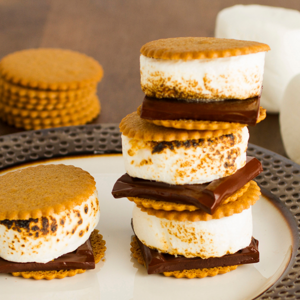 Dewey's Triple Ginger Moravian Cookie Thins sandwiching a crispy marshmallow and chunk of chocolate