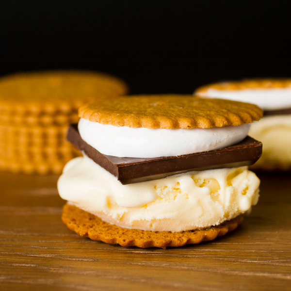 Pumpkin Moravian Cookie Thins S'mores sandwich with ice cream, marshmallow, and a square of chocolate