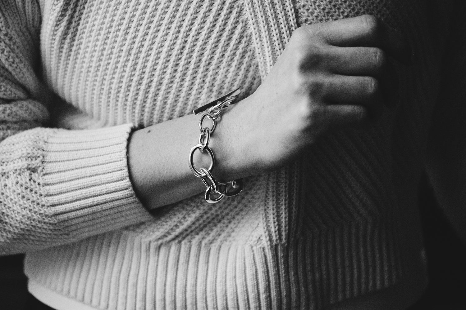 The Alana Bracelet on a model for scale. Image shows the organic, variable sterling silver links, as well as the statement toggle.