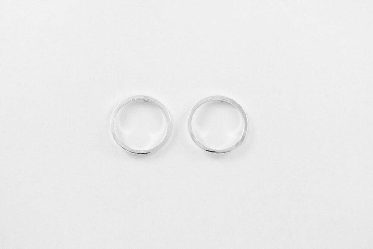 Flat lain photo of the small circle earrings. Simple wire circles on a post - an everyday favorite!